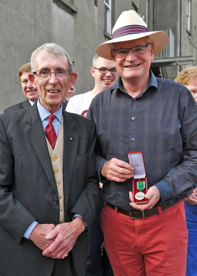 Richard Duc De Stapoole president of the Irish association of the Order of Malta presenting Michael Mc Cormick with the Malta Silver Medal in recognition for his work with malta services at the Golden Jubilee celebrations at the BBQ at Malta Services Photo Jimmy weldon