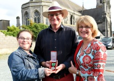Michael Mc Cormick with his wife Audrey and his daughter Megan after receiving the malta silver medal in recognition for his work with malta services at the Golden Jubilee celebrations at the BBQ at Malta Services Photo Jimmy Weldon